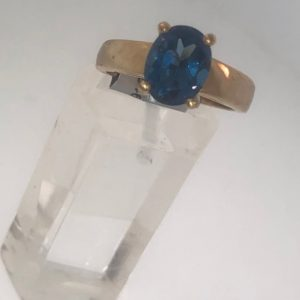 10KY Ladies Solitaire Synthetic Blue Topaz Ring