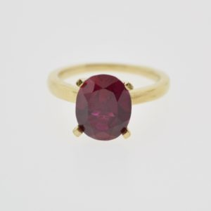 10KY Ladies Solitaire Synthetic Ruby Ring